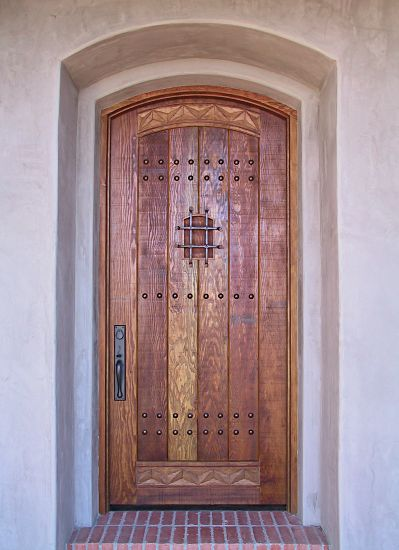Rustic arched top entry door