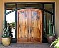 Arched mesquite doors in ebonized frame